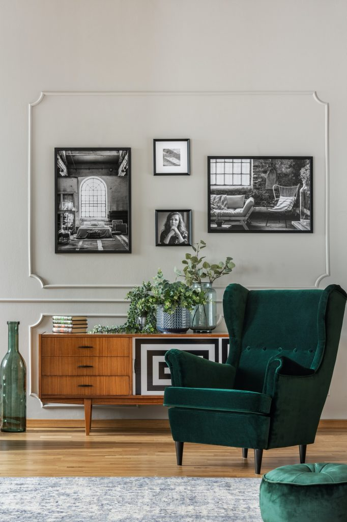 Emerald green armchair in elegant living room with black and whi