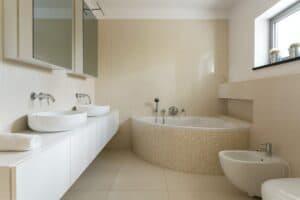 Creamy bathroom with minimalist furniture