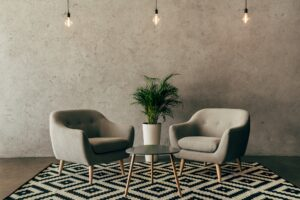 modern interior with vintage furniture in loft style with concrete wall on background