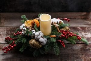 Christmas handmade decor with candle and fir. View with copy space